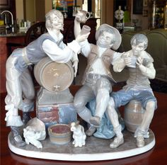 """UPS shipping and packing only !       This is the largest Lladro I've ever seen and it is full of life and gaiety with three men drinking from a barrel of ale or perhaps wine.  The piece, identified by Lladro as Happy Drinkers and on the figure's attached label as Tavern Drinkers was created in 1977 by Salvador Furio and retired in 1985 and is numbered 4956.  It is about 16"""" wide, 9"""" deep and almost 16"""" tall.  I am including a Lladro #4901, """"Vagabond Dog"""" with it and it appears to once have…"""