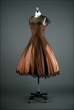 Cocoa-colored sheer-sleeve 1950s dress.