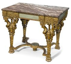 A Louis XVI style paint decorated and carved giltwood table de milieu after a model by George Jacob circa 1900.