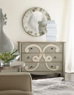 A bold artistic motif adorns the Classique Scroll Chest, and the three drawers are lined with pretty wallpaper.    Three drawers with wallpaper interior.    Hardwood Solids & Veneers.