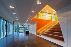 """Completed in 2013 in Hamburg, Germany. Images by Bernadette Grimmenstein. The """"Centre for Speech and Movement"""" (SBZ), a project of the International Building Exhibition (IBA) in Hamburg, had its official public opening on. Lobbies, School Design, Stairs, Indoor, Building, Home, Workplace, Basketball Court, Public"""