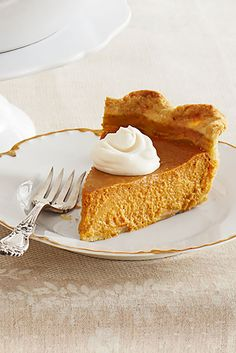 Pumpkin Pie with Rum Whipped Cream  - CountryLiving.com