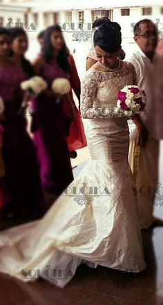 Bride carefully stepping out in her beautiful wedding gown by Soucika! #Soucika #kamalrajmanickath #weddinggown