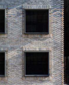 "Multi-tonal brick facade of New York City apartment block references neighbourhood's ""gritty"" past"