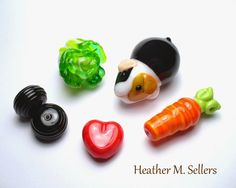Snack time with Acorn the guinea pig. A fun set of lampwork glass beads by Heather Sellers.