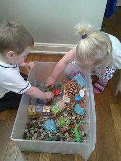Dinosaur sensory bin with water
