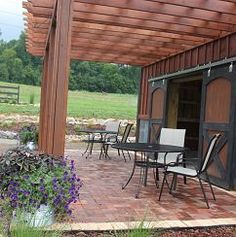 The Barn Patio Pergola Area - the potted plants have finally taken off!