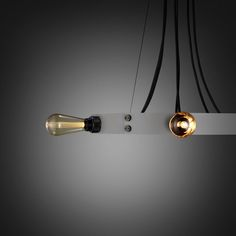 HERO LIGHT / STONE by buster+Punch. A chandelier with six light pendants made from solid metal and matt rubber detailing. The ring is made from 3mm forged steel with STONE powder coating.The light pendants can be set in the ring or left to hang through the centre and can be finished with a choice of bulbs.