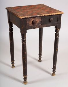 Game Table Stand, New England, 1820s, the black painted four-drawer stand, two of which are faux, has a checkerboard painted on the top; the two small working drawers with single divider and checkers in one operate from the front and rear of the table, original turned wooden pulls and paint, (one divider missing; surface imperfections), ht. 28 1/2, wd. 18, dp. 16 3/4 in.