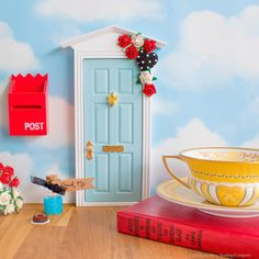 Hand finished Alice in Wonderland Fairy Door. The perfect gift for fans of the famous Lewis Carroll tale. Includes a personalised letter from Alice