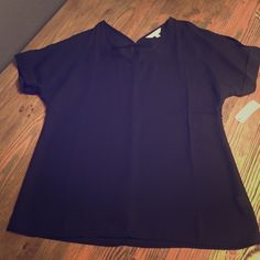 """Black top with """"Peek a boo"""" shoulders Can be dressed up or down, flowy short sleeve shirt with shoulder cut outs. NWT Charming Charlie Tops Blouses"""