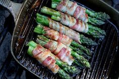 Bacon Wrapped Asparagus  Preheat oven to 400 Divide asparagus into bundles of 3-4 spears Wrap each in a slice of bacon In a saucepan, melt a stick of butter, 1/2 c. brown sugar, 1Tbspn soy sauce, 1/2 tsp garlic salt, and 1/4 tsp black pepper and bring to a boil. Pour mix over bundles and bake until bacon looks done. Can also be grilled