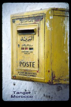 The place is Tangier Morocco, the box looks like French boxes; in form and color. The text is in Arabic and French with the French reminded not to drop newspapers in the post box. When will the mail be picked up - there is an elaborate set of windows for date and time, but they have been obliterated. Could use a coat of paint...