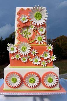 Three tier white and orange 1960's style wedding cake