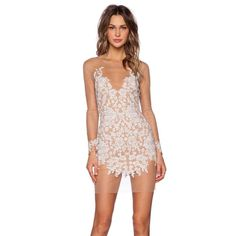 "For Love & Lemons Luau Mini Lace dress Get your game lace on. The Luau Dress has a sheer nude lace shell and features white floral embroidery, raw hemline, and partial nude lining. Slight stretch, side zip closure. We love it teamed up with gladiators and a denim jacket for a day look, or minimal heels and a moto jacket for the after party. By For Love & Lemons. *Polyester/Spandex/Elastan  *Runs true to size  *Model is wearing size small  *Dry clean  •Shoulder seam to hem measures approx 36""…"