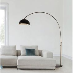 This modern lifestyle Arched Floor Lamp provides an industrial look to any contemporary environment. The rounded, black marble base secures a steel arc which reaches over sectionals and sofas for functional over head lighting. Curved Floor Lamp, Tree Floor Lamp, Arc Floor Lamps, Silver Floor Lamp, Black Floor Lamp, Contemporary Floor Lamps, Modern Floor Lamps, Modern Table, Elegant Living Room