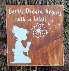 """12"""" x 12"""" wooden sign This delightful sign features a precious little girl with curls blowing the seeds of a dandelion to make a wish. Perfect for a nursery, li"""