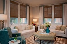 Bamboo blinds for family room...plus adding color to the current drapes with a band of aqua
