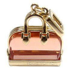 1stdibs.com | LOUIS VUITTON Alma Pink Glass Yellow Gold Pendant Charm