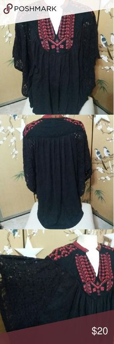 Free People Tunic black w.ethnic embroidery L-XL Free People Tunic black w.ethnic embroidery L-XL...the inside tag is marked on...it looks brand new and I did not see anything wrong w.it...couldn't make out the size it is a roomy flowy Tunic should fit for size L to XL...the winged sleeves are out of lace material the front and back out of a Tshirts one. Free People Tops Tunics