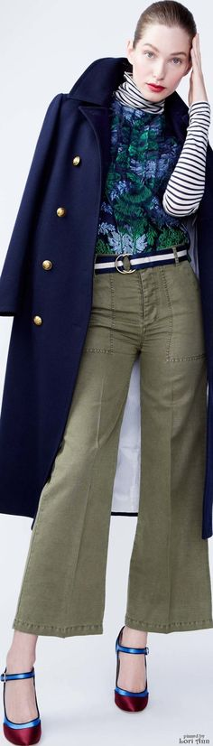 Olive green pants, striped shirt, blue and green printed shirt, navy jacket, red lip, red and blue shoes