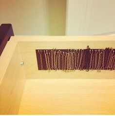 Bobby pins on a magnetic strip! To all the girls who visit and live in my house off and on. Some one buy some of this magnetic strip! I hate the bobby pins all over the house!