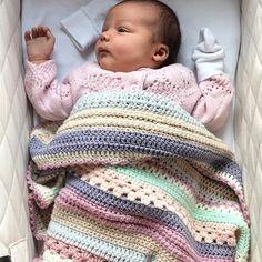 My great niece baby Willow snuggled under my sampler blanket isn't she adorable #ricodesign #babyblanket #grannystripe #babycrochet…