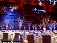LED lighted centerpiece bouquets being used in a winter themed wedding.