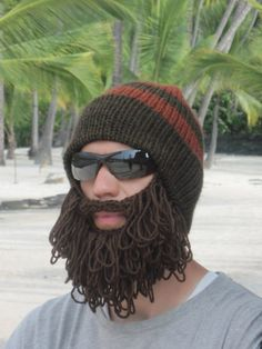 Hat with attached beard. Would anyone else like to know why there are what appear to be palm trees in the background?