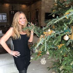 Pin for Later: See How All Your Favorite Celebrities Got in the Holiday Spirit  . . . And posed by the tree.