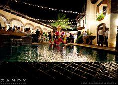 Outdoor wedding reception under cafe lights.