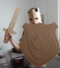 Cardboard Shield for your little knight. Diy craft for kids fun and games. Cardboard Sword, Cardboard Costume, Cardboard Toys, Cardboard Playhouse, Cardboard Furniture, Crafts With Cardboard, Thick Cardboard, Diy Crafts For Kids, Projects For Kids