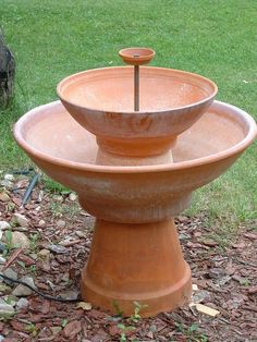 DIY terra cotta fountain... ooooh this would be so cool outside! Also great for planting succulents!