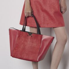 Emporio Armani bags go sporty for Resort 2015 collection. www.handbag.com