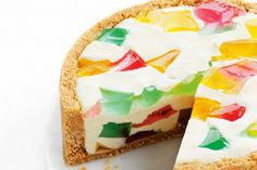 We put a lot of fun into a luscious cheesecake with a rainbow of jelly cubes.