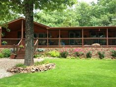 A 2002 lake side double wide received a complete manufactured home remodel and becomes a log cabin dream home. A remarkable transformation!