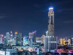 Featuring panoramic views of Bangkok, Baiyoke Sky Hotel stands at making it Thailand's tallest hotel. Thai Travel, Solo Travel, Bangkok Hotel, Bangkok Thailand, Pattaya Bangkok, Best Travel Sites, Dubai, Unique Hotels, Free Park