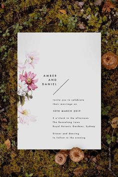 Stunning modern floral Wedding Invitation by Sail and Swan Studio. The design features pale blush daisy flowers and petals with modern, clean, minimal writing.