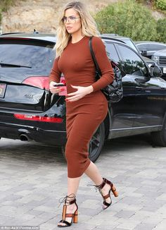 Showstopper: The Keeping Up With The Kardashians hit the pavement in black, orange and maroon heels with a lace up detail