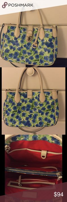 Dooney's floral bag like new With crossbody strap and compartments inside. Super clean like new. Comes with a dustbag. Ship same day :)) Dooney & Bourke Bags Crossbody Bags