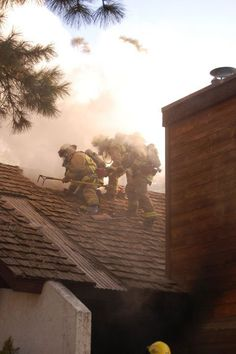 Member and Flagstaff, AZ IAFF Local 1505 Past president Captain Dave Manning sent us this picture of himself and local members Firefighter Ryan Church and Firefighter Colin Challifour vent the roof on a residential fire.