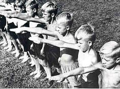German boys giving the Nazi salute, 1933.  During the summer the Nazi party would sponsor day vacations by the river for children.