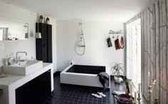 Black white bathroom design with hugo costum made bathtub bathroom