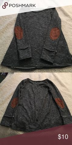 Button back shirt with Elbow patches. NWOT Long sleeved sweater like material shirt. Button detail on back with brown/tan elbow patches. Size medium, fits a little snug though. Never worn (besides initial try-on) Sweaters Crew & Scoop Necks