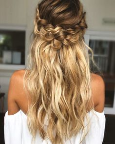 We LOVE this boho wedding hair idea with a wrap-around braid and toussled waves! Check out The Best Long Bridal Hair Styles For Your Wedding Day in this round-up on Wedding Ideas today and get your beautiful bridal look sorted!