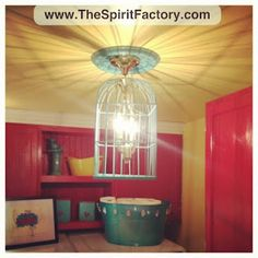 I used an old birdcage and OLD brass light to make a light for my laundry room. #DIY #crafty
