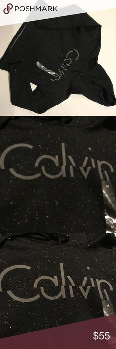 NWT Calvin Klein black spotted pull over hoodie Calvin Klein  New with tags Black hoodie with white specks and a gray logo on the front No flaws Size medium  Bundle and save! Prices are always negotiable 💜💙 Calvin Klein Tops Sweatshirts & Hoodies