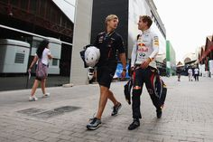 Heikki Huovinen Photos Photos - Sebastian Vettel (R) of Germany and Red Bull Racing talks with his trainer Heikki Huovinen as they walk to their team garage before practice for the European Grand Prix at the Valencia Street Circuit on June 22, 2012 in Valencia, Spain. - European F1 Grand Prix - Practice