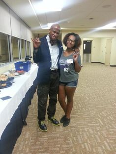 Motivational speaker, Jonathan Sprinkles, and ESU AVID participant, Monique show their stinger pride