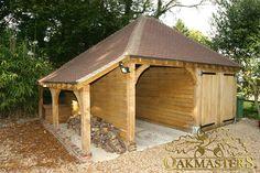 Two bay oak framed garage with log store.